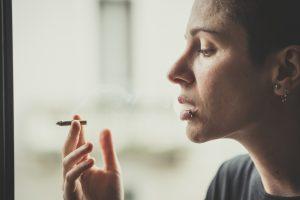Young Lesbian Stylish Hair Style Woman Smoking