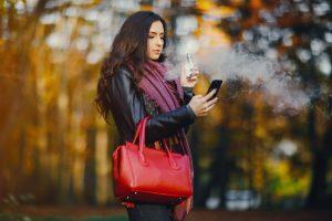 Brunette Girl Is Smoking An E Cigarette