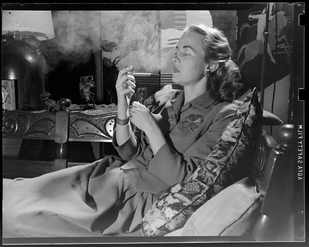 Vintage Women Smoking Pipe