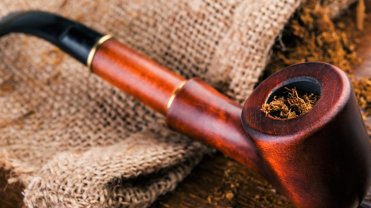 Smoking Pipe And Tobacco On Brawn Wooden Table.